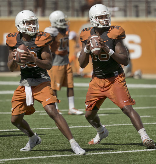 (USE THIS PHOTO LEAD ON SPORTS) The battle for the Texas quarterback position seems to start with incumbent starter Tyrone Swoopes, right, as backup Jerrod Heard, left, is pushing for playing time this year. Texas head coach Charlie Strong leads his team during a fast-paced practice as the Longhorn football team held an open practice and fan appreciation day at Darrel K. Royal memorial Stadium Sunday August 9, 2015. RALPH BARRERA/ AMERICAN-STATESMAN